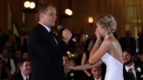 groom surprises his bride with a surprise song and flash mob at their wedding reception