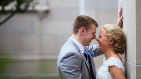 bride and groom ousit of scottish rite cathedral in indianapolis
