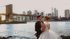 bride and groom standing with manhattan new york in backgound
