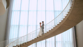 bride and groom on stairs at art institute of chicago